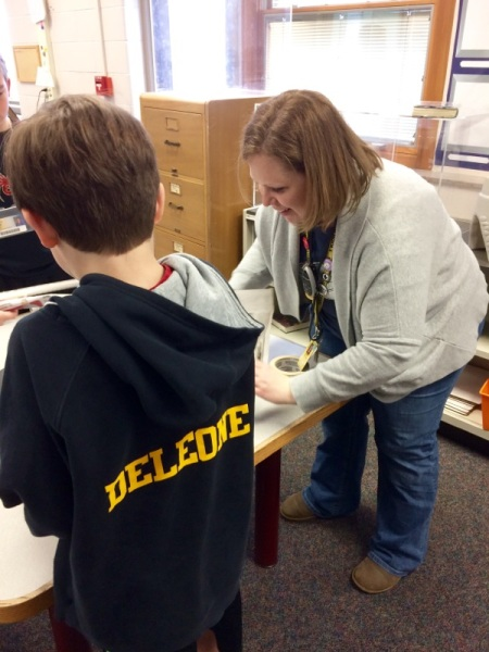 Librarian Shannon Himmelgarn assisting a student during the media center's maker day
