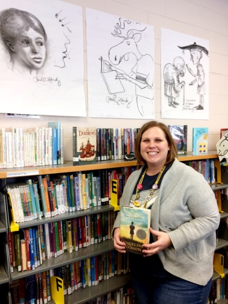 "Shannon Hemmelgarn with her favorite book, ""Brown Girl Dreaming"" by Jacqueline Woodson"